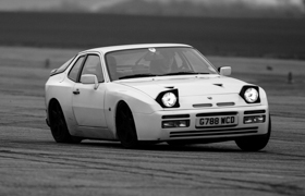 The Porsche 944 leaning heavily on one wheel