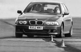 BMW 528i driving round cones